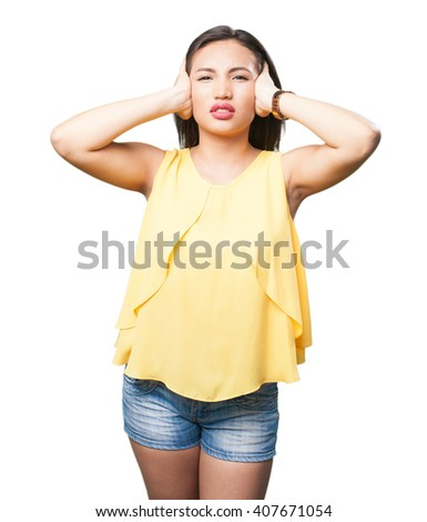 asian woman covering her ears - stock photo