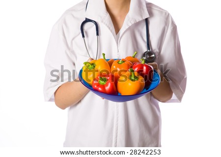 Asian woman doctor offering bowl of colored peppers