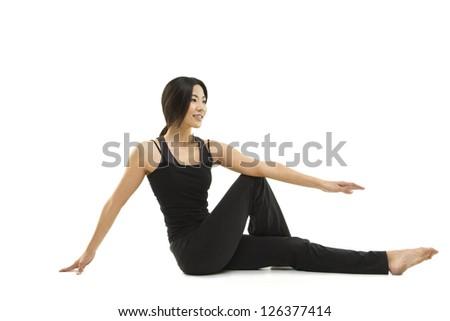 Asian woman doing a yoga pose - stock photo