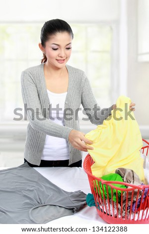 asian woman doing the laundry at home - stock photo