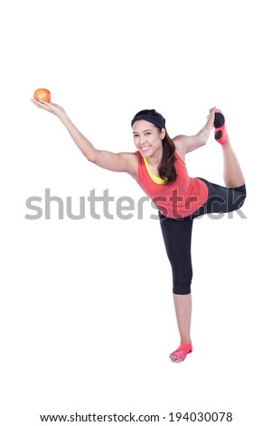 asian woman doing yoga with apple isolated on white background - stock photo