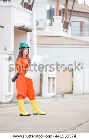 asian woman engineer wearing protective workwear at work