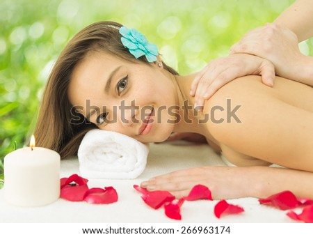 asian woman enjoying a massage in the spa. concept about massages, wellness, body care and people - stock photo