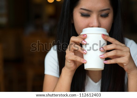 asian woman enjoying coffee in the morning