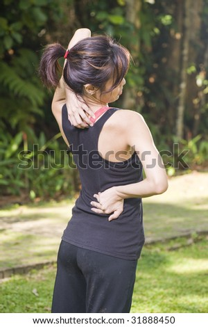 asian woman experiencing backache after exercise - stock photo