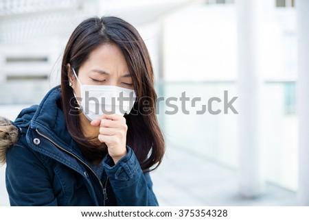 Asian woman feeling unwell - stock photo