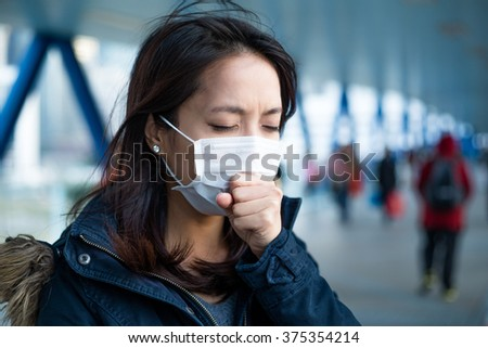 Asian Woman feeling unwell at outdoor - stock photo