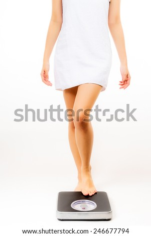 asian woman feet on scales in white background - stock photo