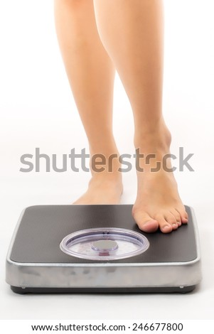 asian woman feet on scales in white background