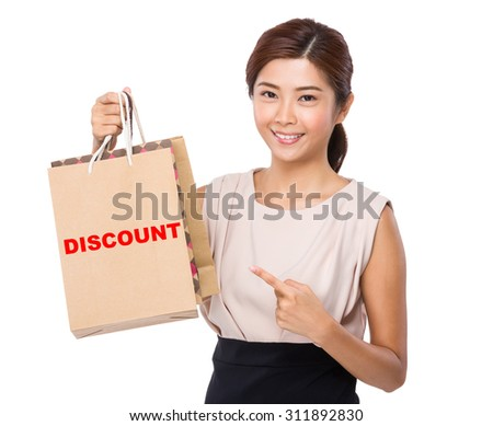 Asian woman finger point to shopping bag and showing a word discount