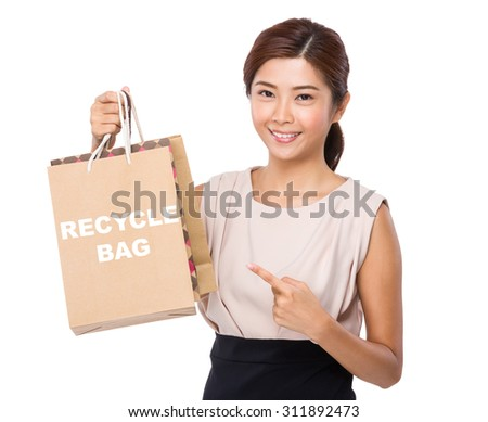 Asian woman finger point to shopping bag and showing phrase of recycle bag