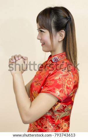 Asian woman greeting traditional chinese cheongsam stock photo asian woman greeting in traditional chinese or cheongsam with hand lift welcome expression and lucky in m4hsunfo