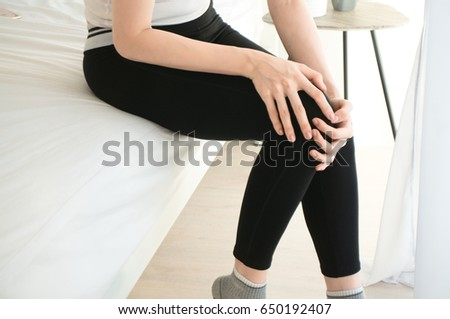 Asian woman have knee ache in morning white room