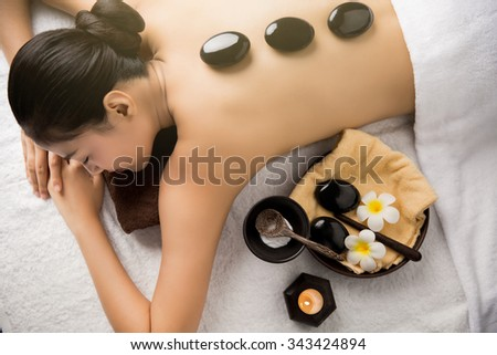 Asian woman having massage and spa salon Beauty treatment concept. She is very happy - stock photo