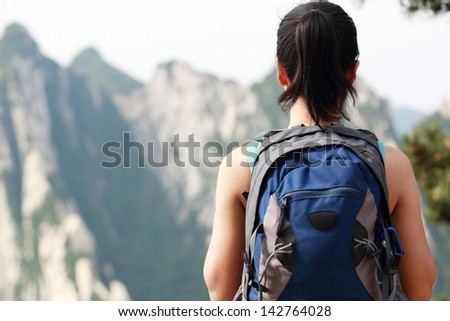 asian woman hiker at mount hua - stock photo