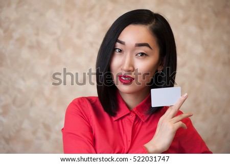 Asian woman hold empty card