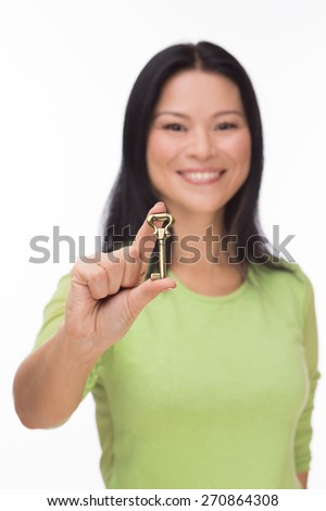 Asian woman hold old key isolated on white