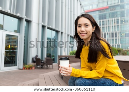 Asian woman hold with coffee - stock photo