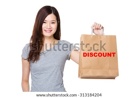 Asian Woman hold with shopping bag for showing a word of discount