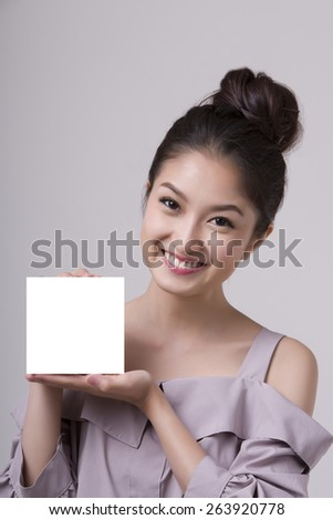 asian woman holding a blank card - stock photo