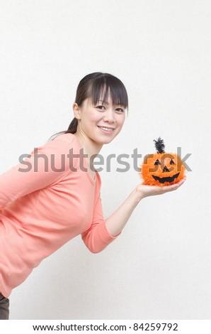 Asian woman holding a pumpkin - stock photo