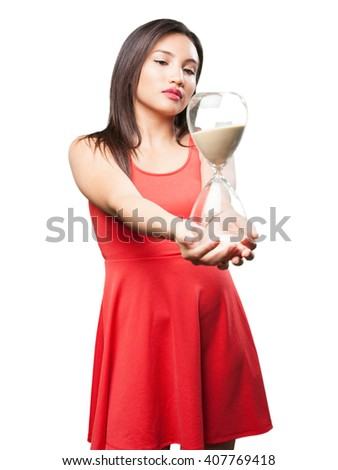 asian woman holding a sand timer - stock photo