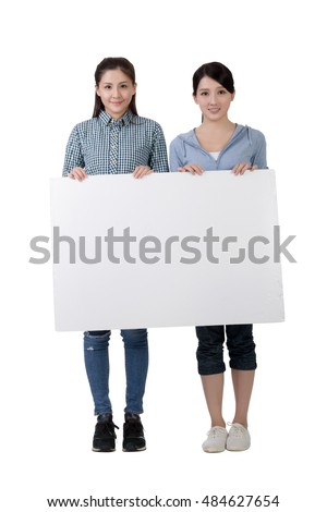 Asian woman holding blank board with friends, full length portrait on white background.