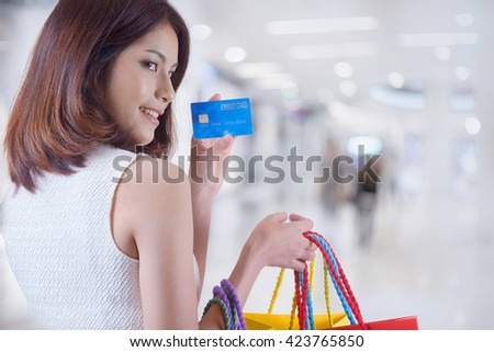 Asian woman holding credit card, Shopping Bag, in shoping mall. - stock photo