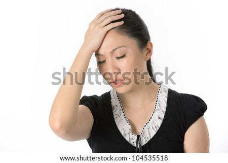 Asian woman holding head whilst having a headache. isolated on white background