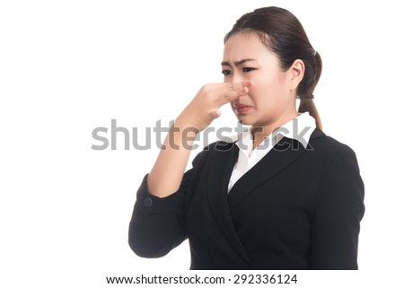 Asian woman holding her nose because of a very bad smell,something stinks,Closeup portrait of beautiful Asian woman,Thai girl,Negative human emotion facial expression,isolated on white background - stock photo