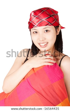 asian woman holding red pillow