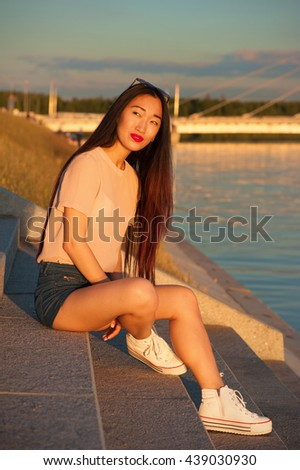 Asian woman in city outdoors