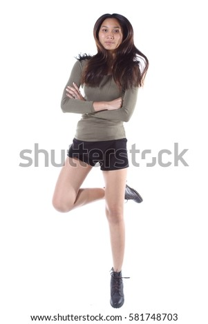 Asian Woman in Military Green long sleeve short black jean long black hear, jump drama happy and joy smile, studio lighting white background