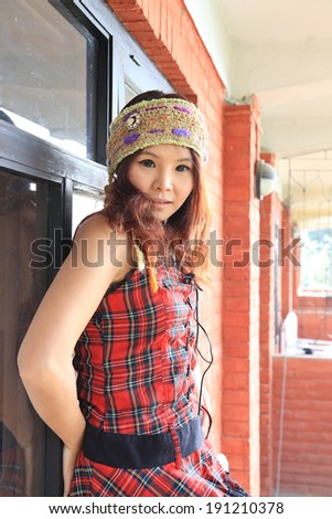 Asian woman in red tartan pattern dress with handmade hairband