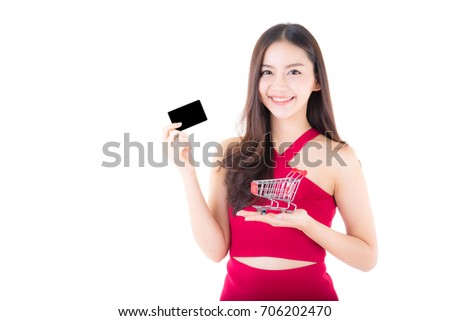 Asian woman in shopping concept isolated on white background girl holding shopping cart and credit card holding hand.