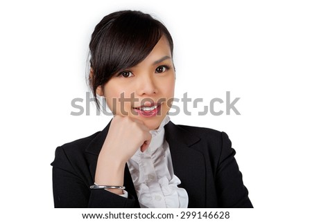 Asian woman in suit, thinking - stock photo