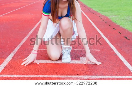 Asian woman is running in running track stadium