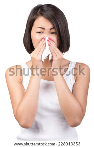 Asian woman is suffering from colds and runny nose. Portrait on white background.