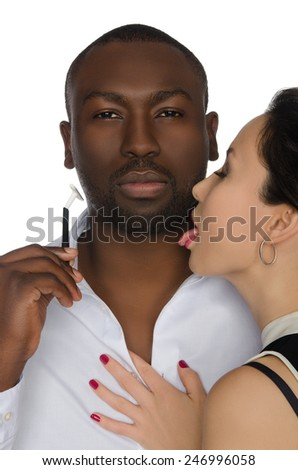 Asian woman licks his cheek dark-skinned men with razor isolated on white - stock photo