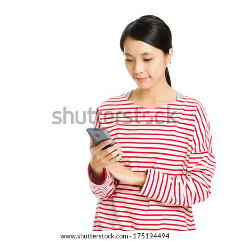 Asian woman looking at mobile phone - stock photo