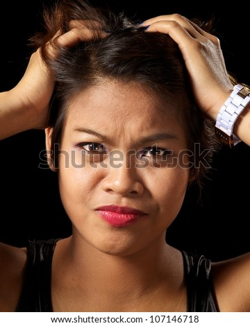 Asian woman looking very frustrated - stock photo