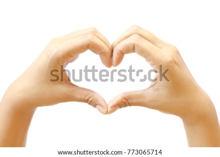 Asian woman make her hand like heart shape sign of love on white background