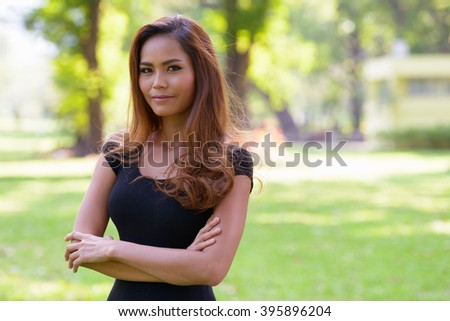 Asian woman outdoors in park