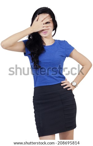 Asian woman peeking from fingers, isolated on white background - stock photo