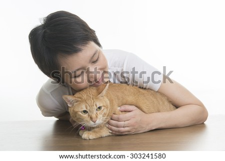 Asian woman playing with cat