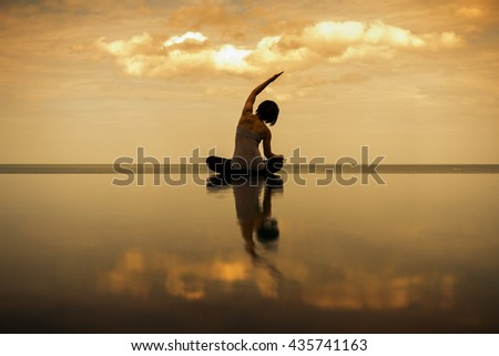 asian woman practice yoga with sea and sky