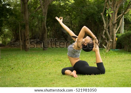 Asian woman Practicing yoga in the morning