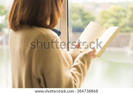 asian woman reading book