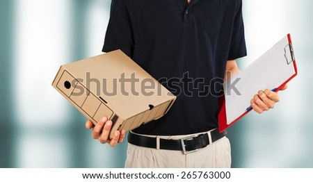 Asian. Woman receiving a package at home from a delivery guy - stock photo
