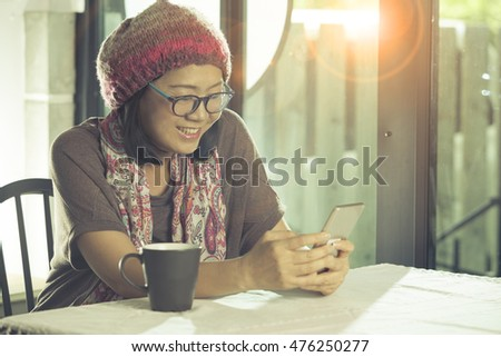 asian woman relaxing emotion happiness face looking to smart phone and reading text on screen